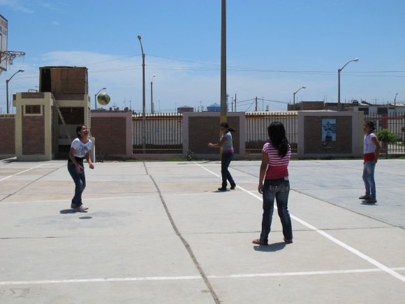 the girls practicing their volley skills.