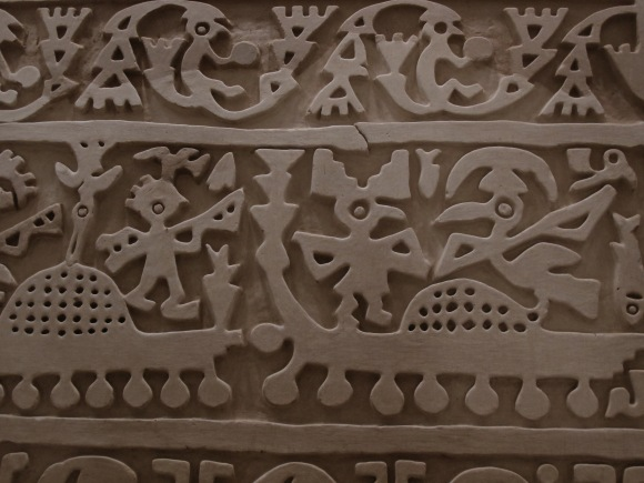 traditional mochican wall carving.